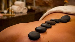 Back massage with hot basalt, stones