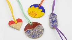 Clay jewelry with a coating of resin
